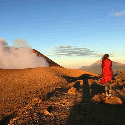 Woman walking close to the Telica Volcano Crater in Nicaragua
